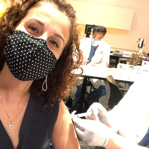 kathy k., LVN receiving vaccine